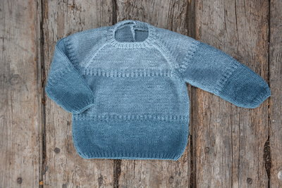 Breipakket trui in degradé blauw