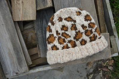 Breipakket muts met luipaardprint